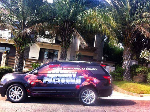 Pacquiao's campaign car allegedly parked outside his mistress's mansion