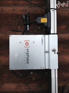 M215 Enphase Micro Inverter mounted to rail
