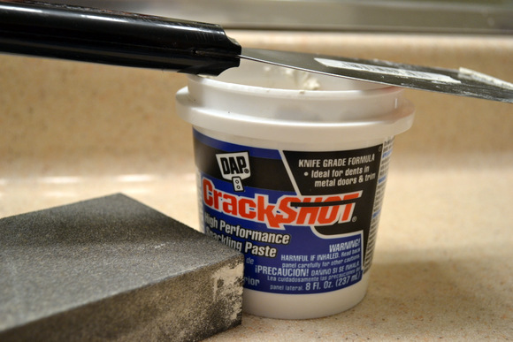 Spackle to repair the wall