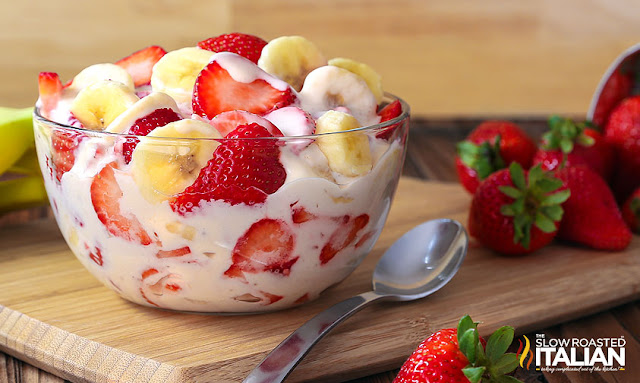Strawberry Banana Cheesecake Salad in a bowl, with a spoon