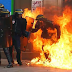 Officer is set alight and 62 arrested in Paris as citizens take to the streets in protest at new labour laws