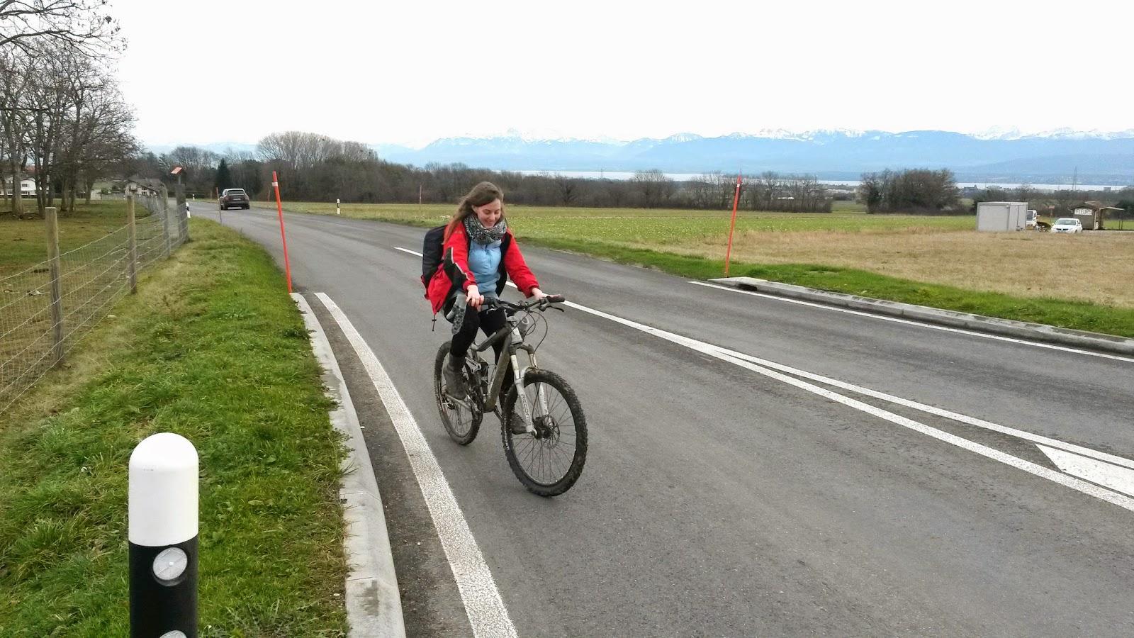 Rebecca Molloy on bike toward forest