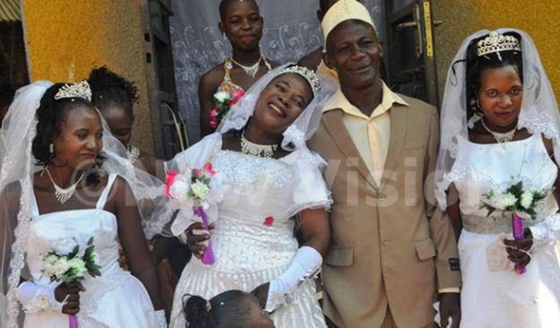 50-year-old man from Uganda marries 3 wives at once & two of them are sisters (Photos/Video)
