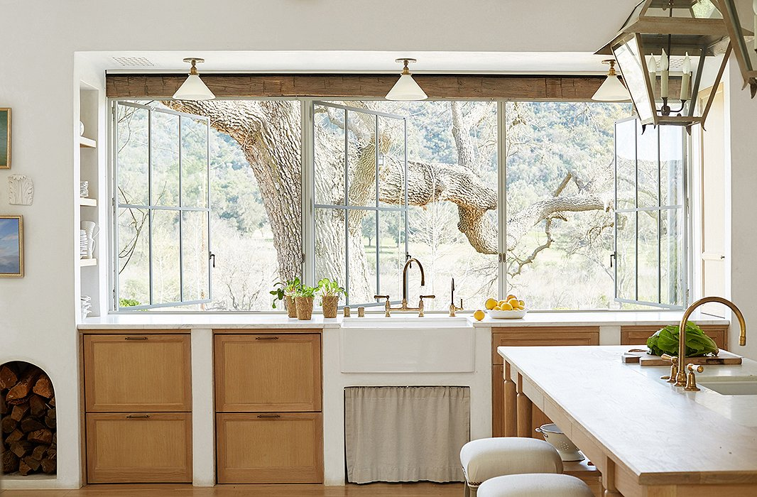 Glorious light flooding the industrial style windows in an organic California #modernfarmhouse kitchen in #PatinaFarm by #BrookeGiannetti