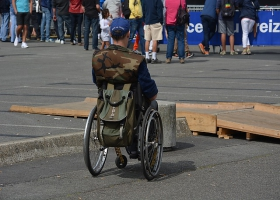 A disabled man on a wheelchair.