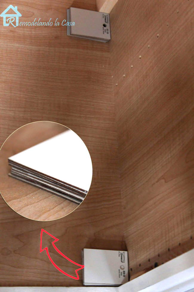 laminate samples are used as a trick to make pantry slides level inside pantry