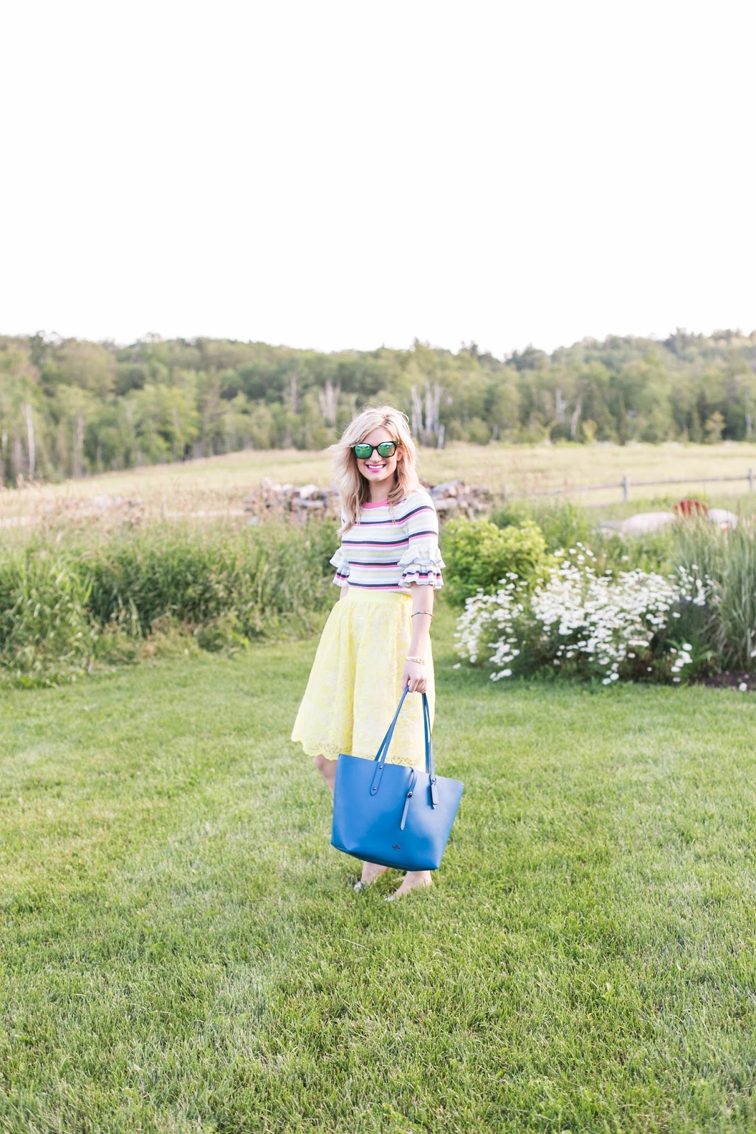 Bijuleni | Colourful ruffle sleeve sweater with lace eyelet yellow party skirt and Coach Tote