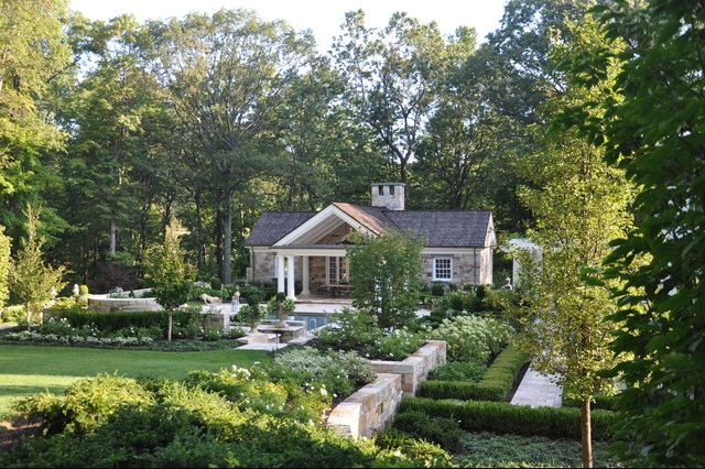 stone walls back yard landscape design white and green