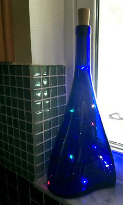 Recycled bottles with colored fairy lights