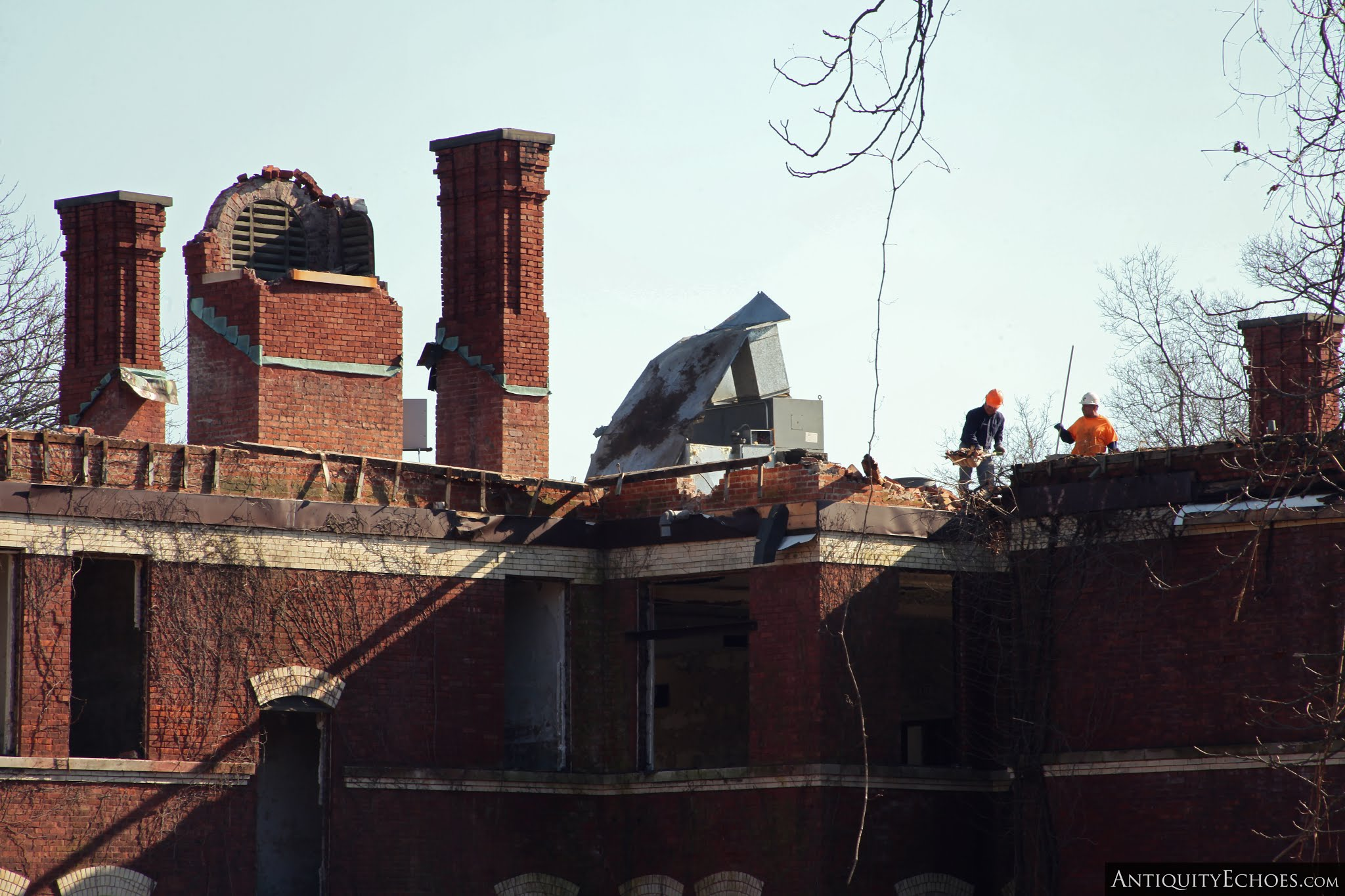 Overbrook Asylum - Workers Remove Debris from a Rooftop