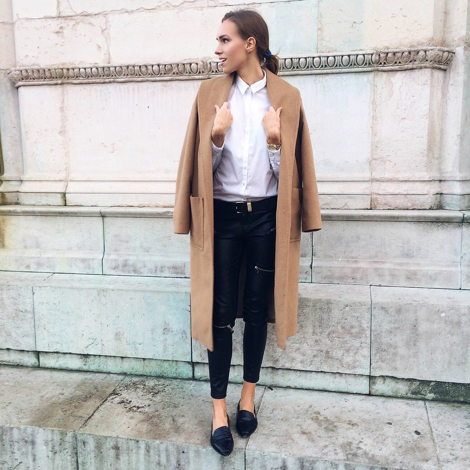 kristjaana mere camel coat white button down shirt leather pants pointed flats minimal winter outfit
