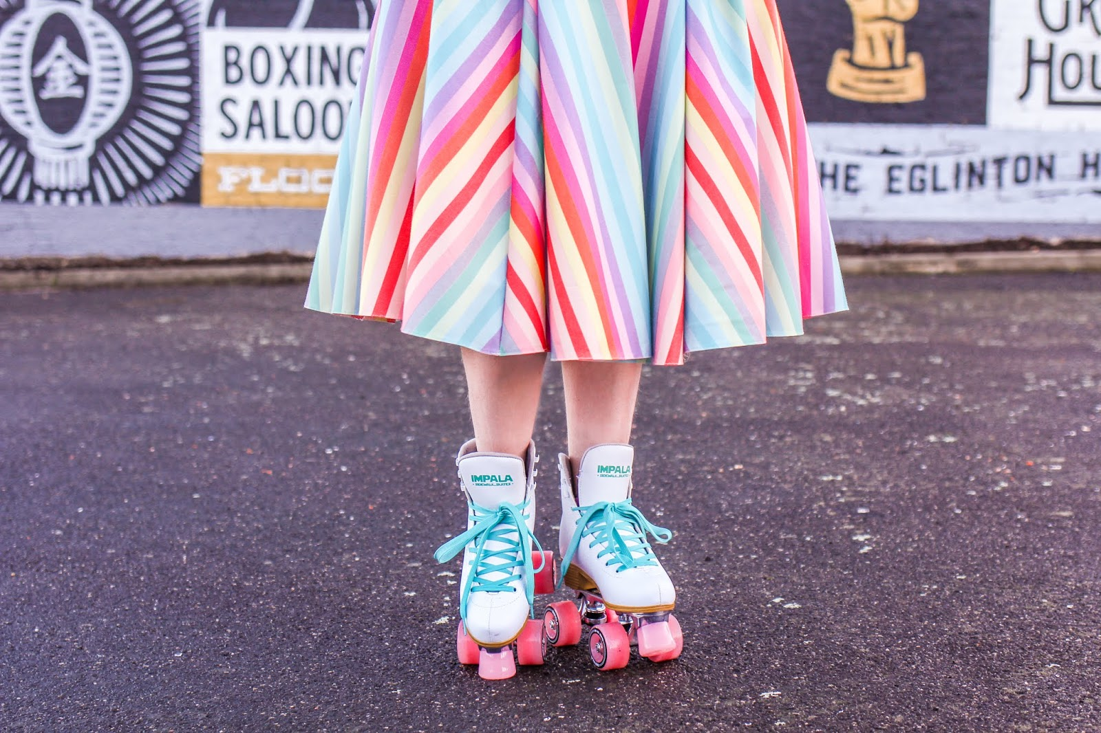 Liana of @findingfemme wears Impala rollerskates and The Pretty Dress Co candy striped dress