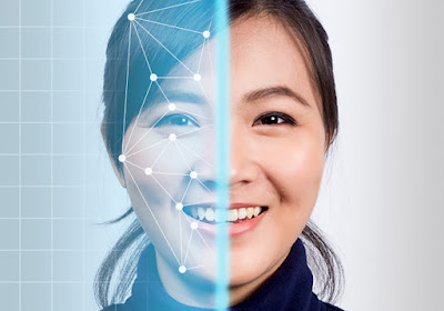 Photo showing face recognition scanning of a woman's face.