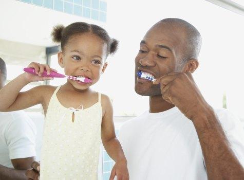 image Dads teaching teens ebony toys the
