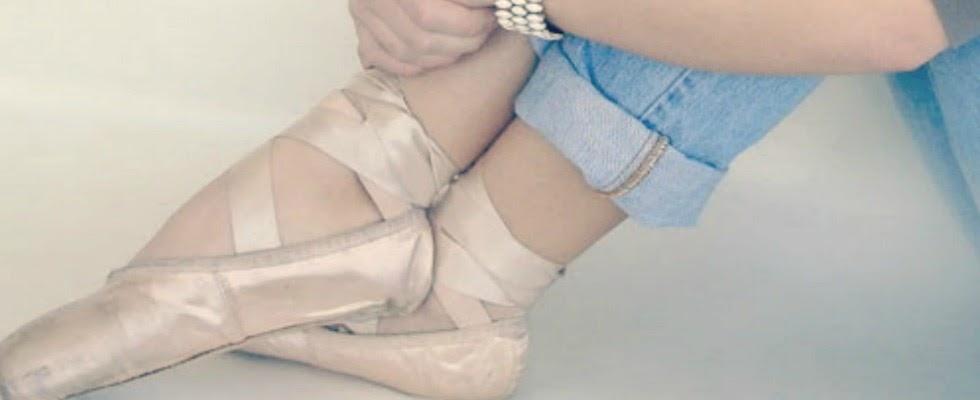 Romatic European pink pointe shoes on a ballerina in jeans - by Hello Lovely Studio
