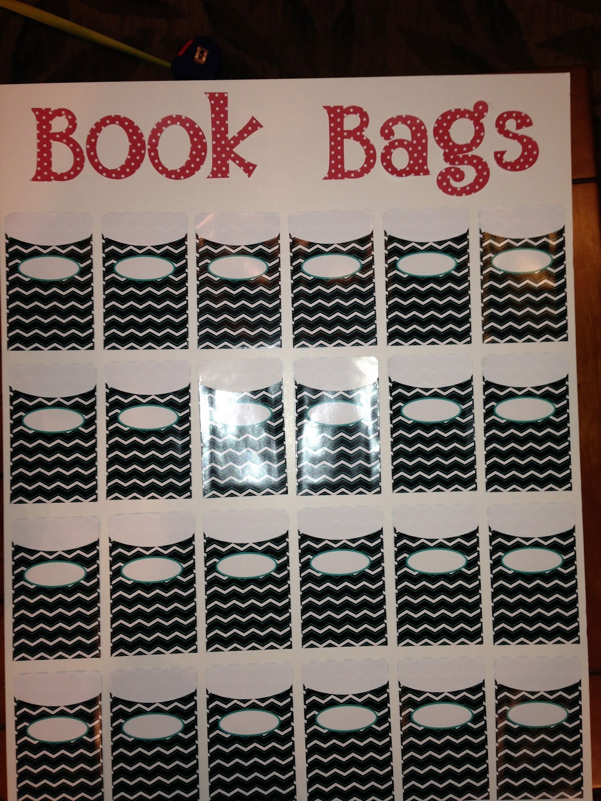 book bag chart, take home readers, chevron library pockets