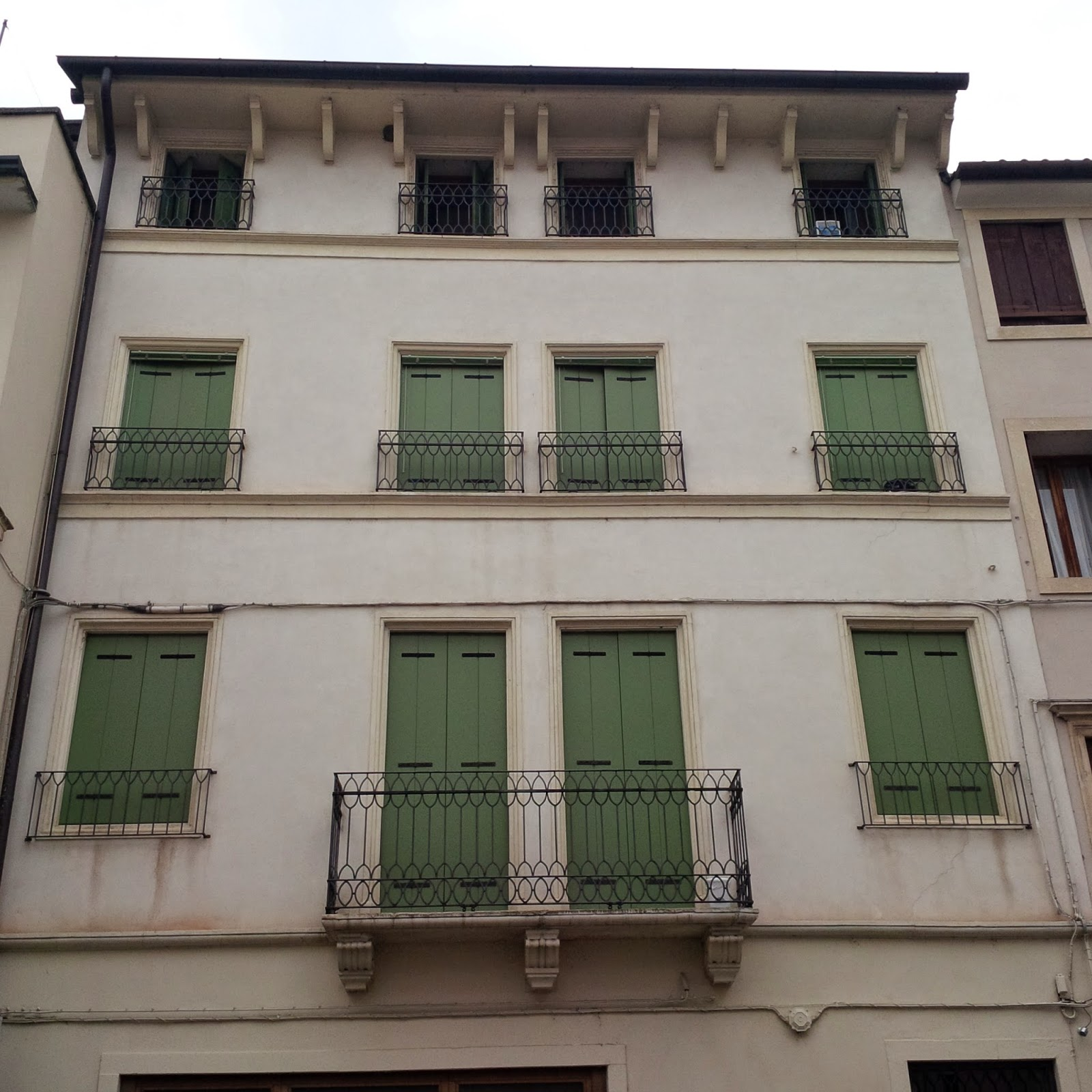 A building with closed shutters in Vicenza