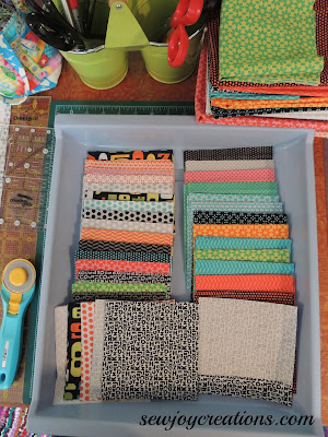 Fabrics cut and stored in their own bin makes it easier to have several projects on the go at once