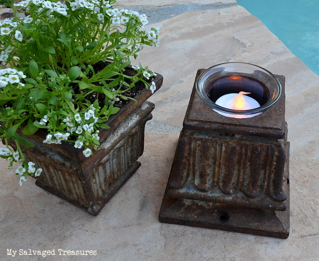 turn a rusty old cast iron post base into a tea light holder
