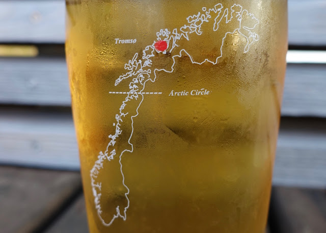 map of Norway on a beer glass. There's a red dot to indicate the town Tromso.