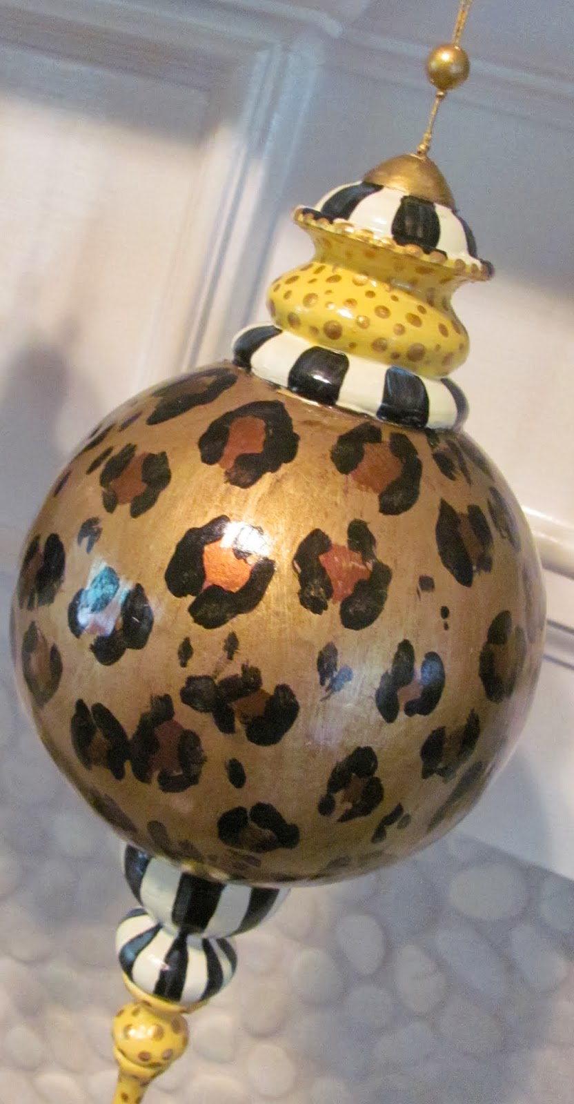 hand painted black and stripe finial ornament with animal print