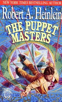 Cover image of the novel The Puppet Masters by Robert Heinlein. Image shows a man literally attached to strings, as if he is a puppet.