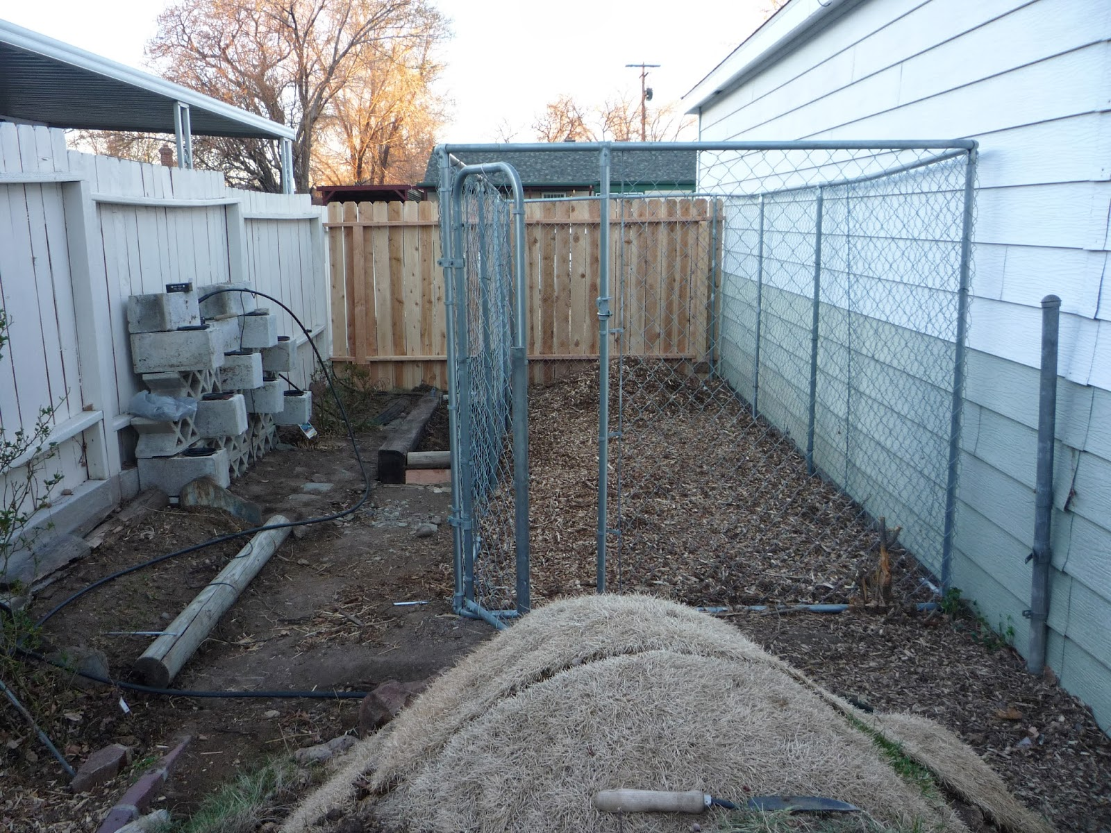 Once The Dog Run Was Up And Skinned With Chain Link We Constructed A Little Planter Four Railroad Ties Three To Form Tall Back Hopefully