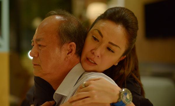 Tommy Tam and Debbie Goh during one of the tearjerking moments in THE KID FROM THE BIG APPLE 2: BEFORE WE FORGET (2017)