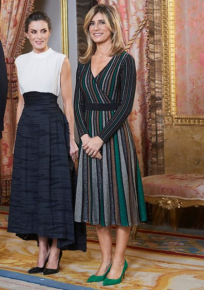 Queen Letizia wore HM Conscious silk-linen blend long skirt. Begona Gomez wore Pedro del Hierro Lurex jersey knit dress