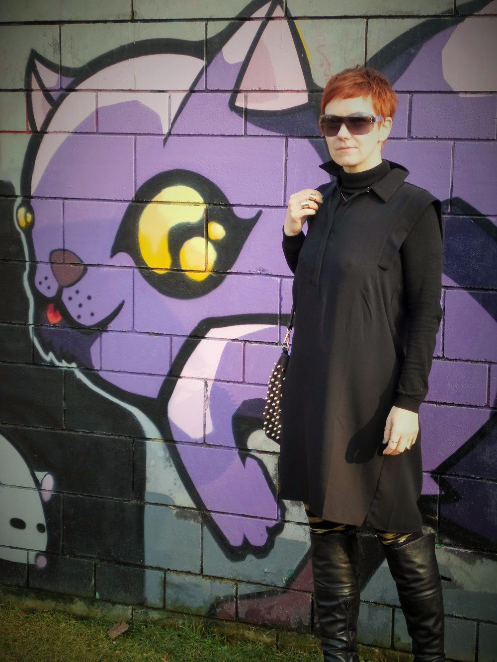 Ralph Lauren visor sunglasses, black shirt dress, black turtleneck, black over-the-boots, black gold foil leggins, graffiti wall