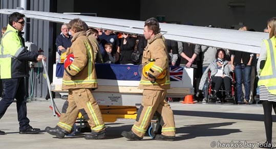 Hawke's Bay firefighters formed guards of honour as the body of former Haumoana volunteer fire chief Bill Tims was brought back to Hawke's Bay Airport, Napier. Mr Tims was killed and his wife Natalie Tims was seriously injured when they were struck by a motorcycle in downtown San Francisco, USA. photograph