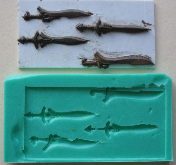 Battle Suits W I P Howling Hounds Press Mold For Swords