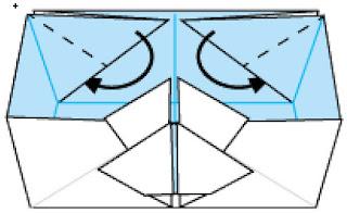 Bước 14: Gấp 2 cạnh giấy xuống như hình vẽ
