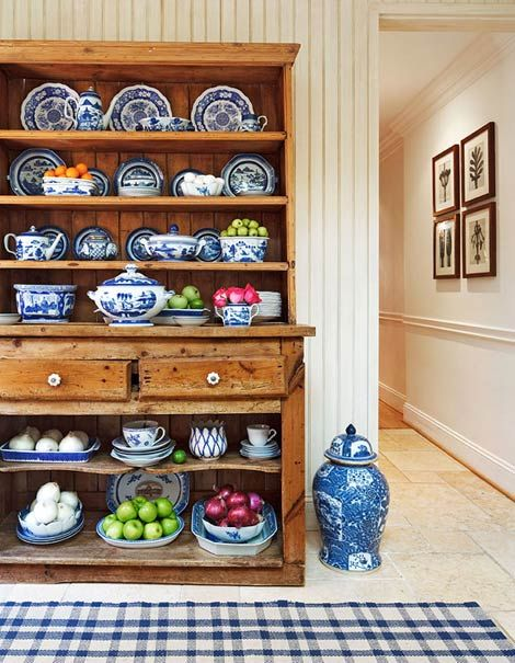 LOVE this antique cabinet full of blue and white dishes.
