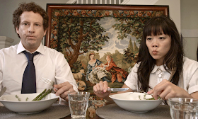 Unhappy couple eating dinner