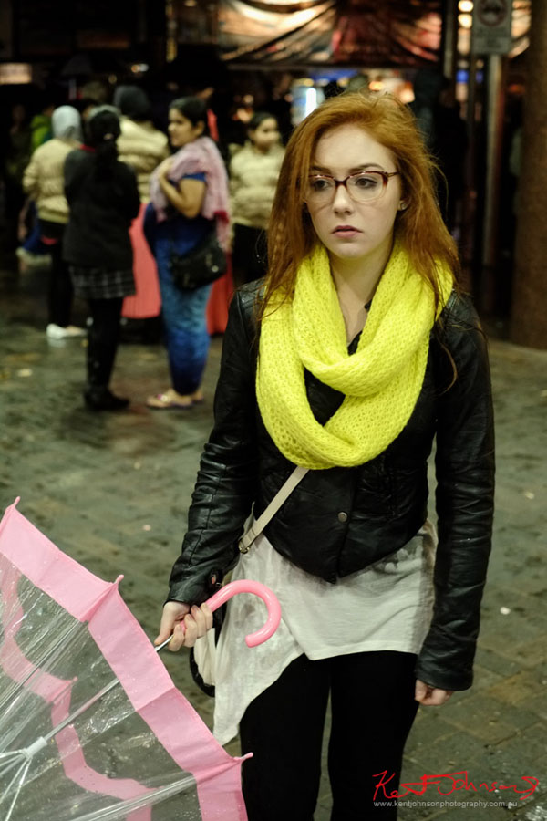 Yellow scarf and pink and clear umbrella at circular quay station - Fujifilm X-Pro1, XF35mmF1.4 R.