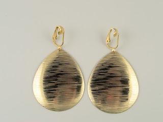 http://www.thecliponearringstore.com/luxury-awaits-brushed-teardrop-clip-on-earrings.html