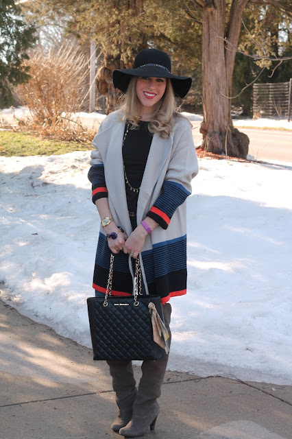 Oversize SheIn cardigan paired with joga jeans, OTK boots, black floppy hat, and Greg Michaels Tote