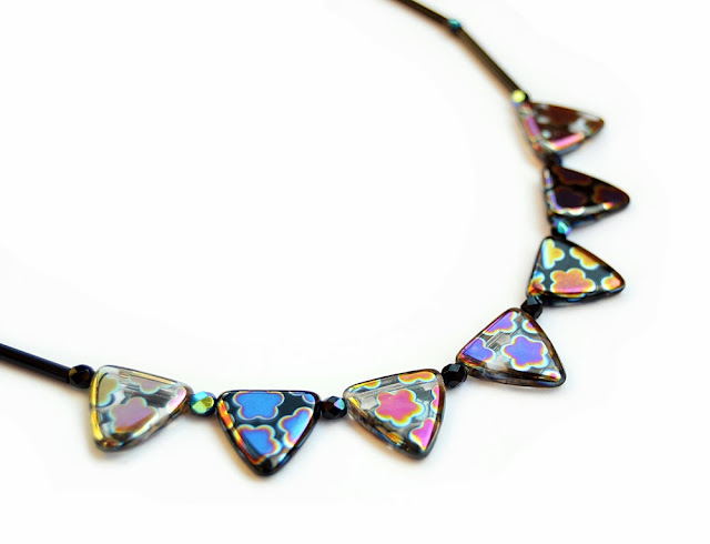 https://www.etsy.com/listing/163617858/necklace-with-triangle-shaped-beads?ref=shop_home_feat