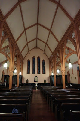 Photo of church interior from alter facing entrance