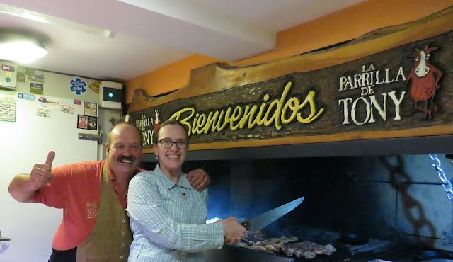 Tony poses by the grill at La Parrilla de Tony in Bariloche Argentina