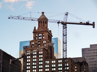 Esperson Building with crane at Skanska Capitol Tower project site