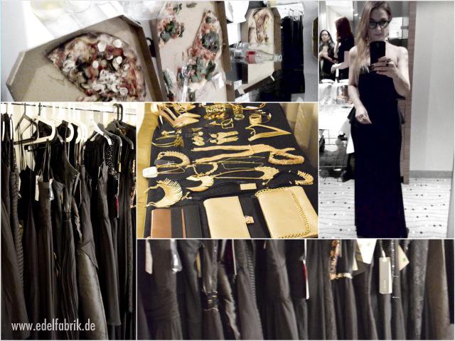 Kleiderstaender voller schwarzer Kleider und Pizza beim Fitting
