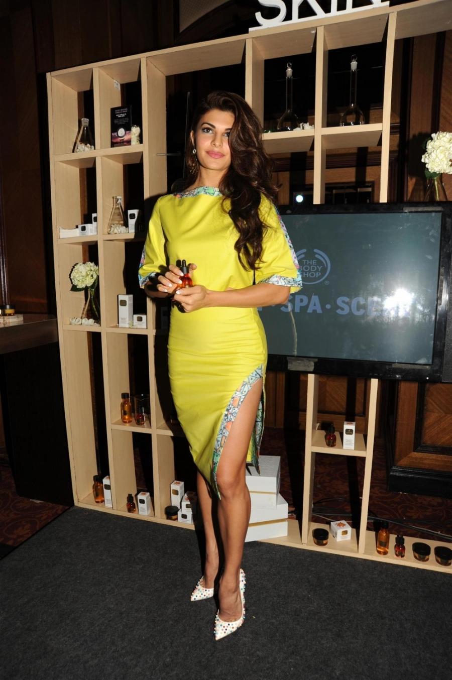 Jacqueline Fernandez Hot Legs Show Photos In Short Yellow Dress