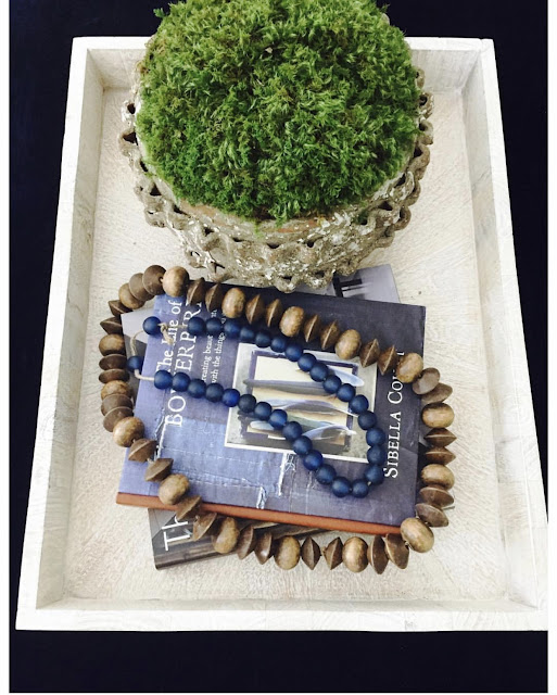 White tray vignette with books, beads, and greenery - design by Sherry Hart. Come discover more inspiring trays for layering and vignettes in Adding Tray Très Chic to Your Home.