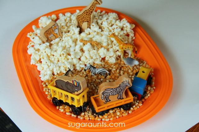 Create a circus themed sensory bin using popcorn!
