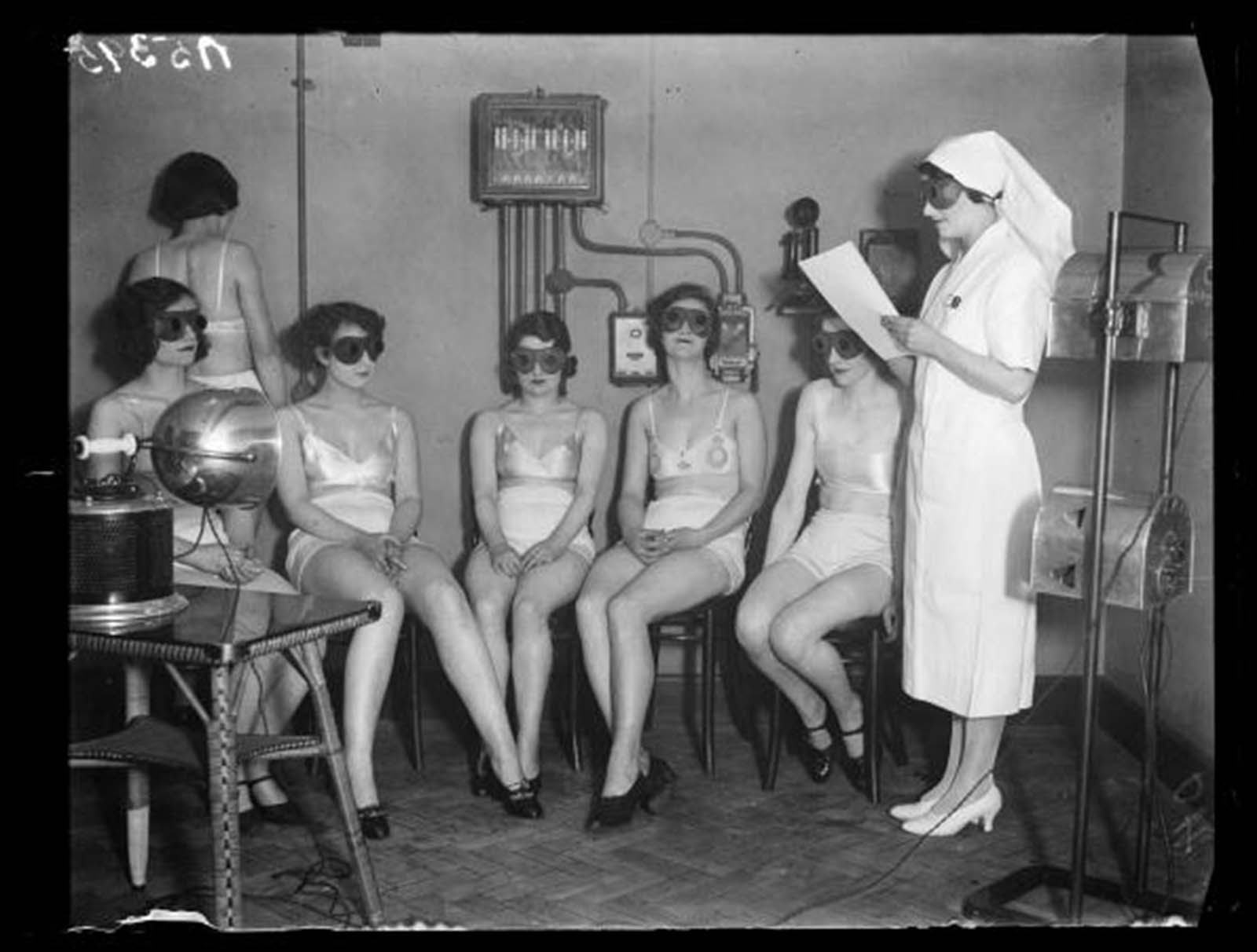 Sunray 'treatment', 20 February, 1932. These women, all Metropole Cinema attendants.