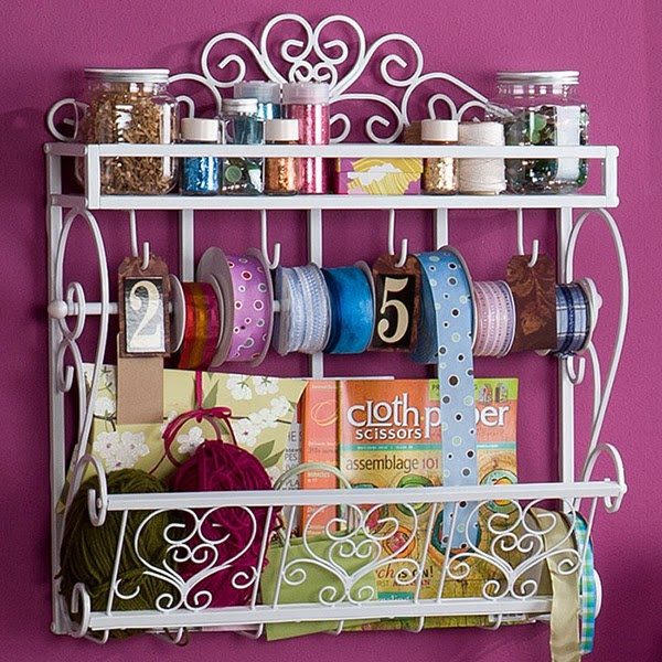 Bathroom storage shelves being used in the craft room for glitter, jars and ribbons