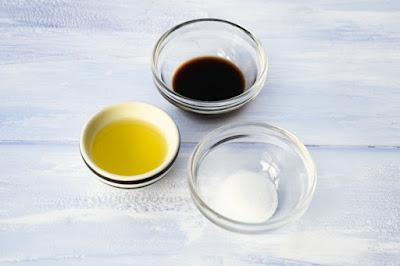 Ingredients to flavour kale crisps. Olive oil, balsamic vinegar and salt.