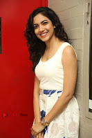 Actress Ritu Varma Stills in White Floral Short Dress at Kesava Movie Success Meet .COM 0101.JPG